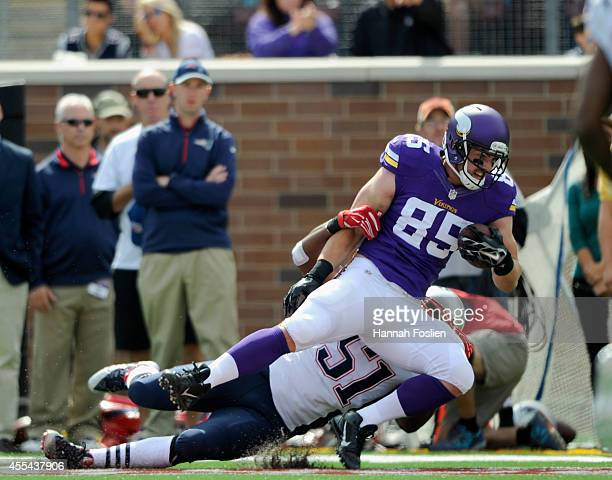 Jerod Mayo of the New England Patriots tackles Rhett Ellison of the Minnesota Vikings during the first quarter of the game on September 14, 2014 at...
