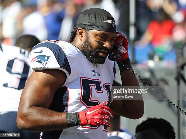 Jerod Mayo of the New England Patriots talks on the phone against the Buffalo Bills during the first half at Ralph Wilson Stadium on October 12 2014...