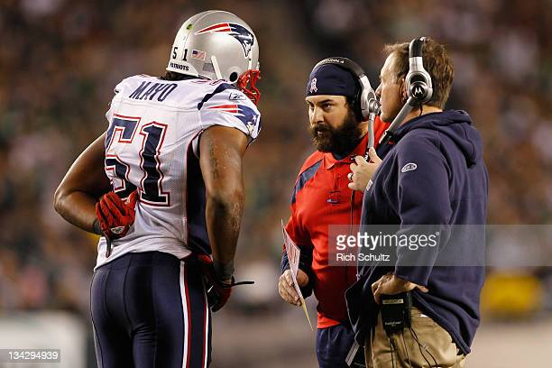 Jerod Mayo of the New England Patriots talks with Safeties coach Matt Patricia and head coach Bill Belichick against the Philadelphia Eagles at...
