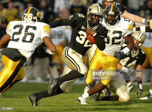 Jerod Void of the Purdue Boilermakers runs with the ball against against the Iowa Hawkeyes November 8 2003 at RossAde Stadium in West Lafayette...