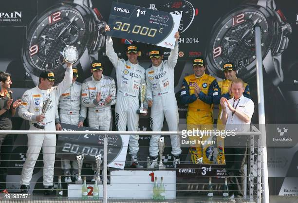 Jeroen Bleekemolen of the Netherlands and Hari Proczyk of Austria drivers of the Grasser Racing Team Lamborghini FLII celebrate with second placed...