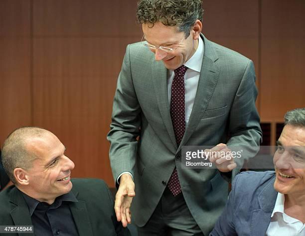 Jeroen Dijsselbloem Dutch finance minister and head of the group of euroarea finance ministers centre greets Yanis Varoufakis Greece's finance...