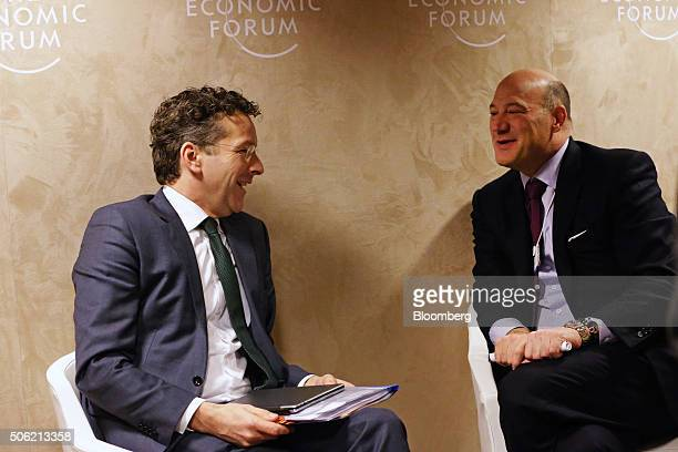Jeroen Dijsselbloem Dutch finance minister and head of the group of euroarea finance ministers left speaks with Gary D Cohn president and chief...