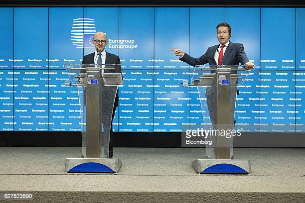Jeroen Dijsselbloem Dutch finance minister and head of the group of euroarea finance ministers right gestures as he speaks while Pierre Moscovici...