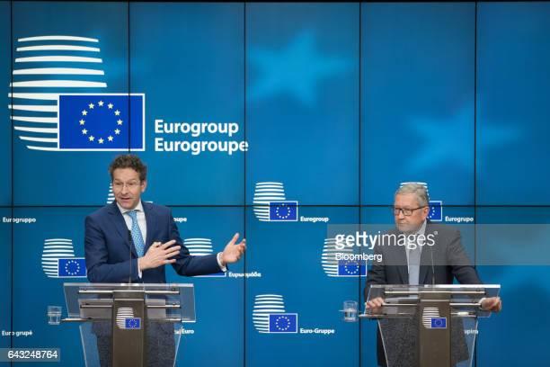 Jeroen Dijsselbloem Dutch finance minister and head of the group of euroarea finance ministers left speaks as Klaus Regling managing director of the...