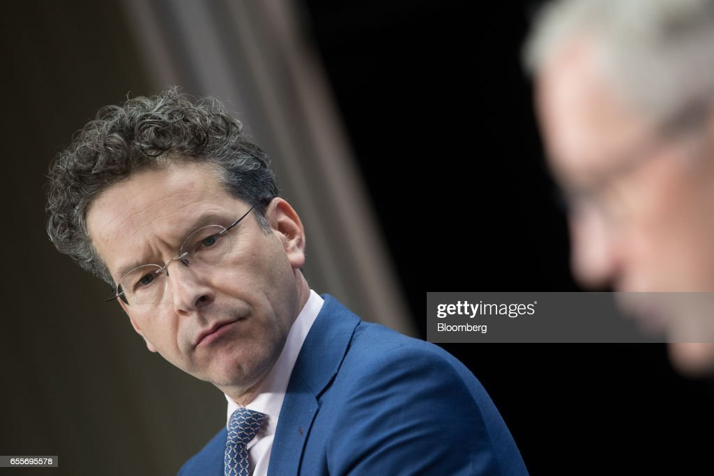 Jeroen Dijsselbloem, Dutch finance minister and head of the group of euro-area finance ministers, listens during a news conference following a Eurogroup meeting of finance ministers in Brussels, Belgium, on Monday, March 20, 2017. Wolfgang Schaeuble, Germany's finance minister, said to reporters ahead of the meeting of euro-area finance ministers We'll get a report on Greece, but the mission isn't completed. Photographer: Jasper Juinen/Bloomberg via Getty Images