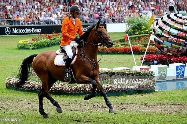 Jeroen Dubbeldam of Netherlands rides on SFN Zenith and won the Rolex European Champion jumping competition on Day 12 of the FEI European Equestrian...
