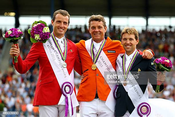 Jeroen Dubbeldamm of the Netherlands presents his gold medal Gregory Wathelet of Belgium presents his silver medal and Simon Delestre of France...