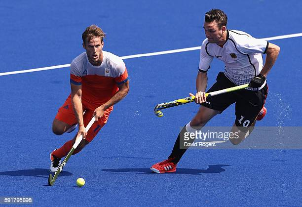 Jeroen Hertzberger of the Netherlands is tackled by Christopher Wesley during the Men's Bronze Medal match between the Netherlands and Germany on Day...