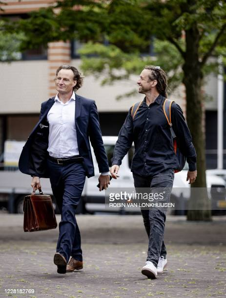 Jeroen Pols and Willem Engel arrive at the court to claim documents on behalf of the Virus Truth Protest Group that form the basis of the corona...