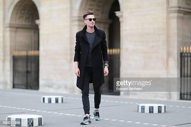 Jeroen Van Es is wearing gray Adidas Originals shoes Diesel black pants an All Saints gray shirt an All Saints black coat Rayban sunglasses and a...