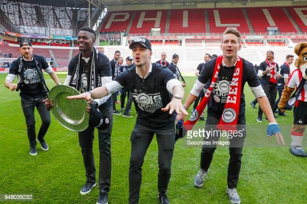 Jeroen Zoet of PSV, Nicolas Isimat of PSV, Marco van Ginkel of PSV, Luuk de Jong of PSV Celebrate the championship during the PSV champions parade at...