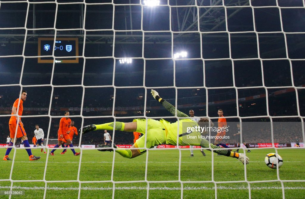 Jeroen Zoet of the Netherlands fails to stop Jessie Lingard of England (2L) from scoring their first goal during the international friendly match between Netherlands and England at Johan Cruyff Arena on March 23, 2018 in Amsterdam, Netherlands.