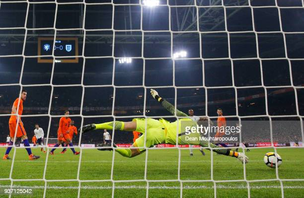 Jeroen Zoet of the Netherlands fails to stop Jessie Lingard of England from scoring their first goal during the international friendly match between...