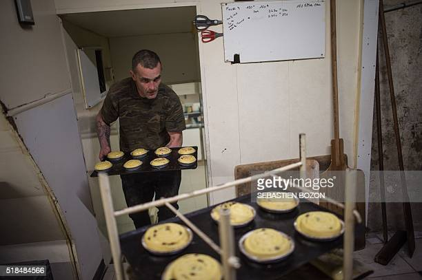 Jerome, a former homeless, works in a bakery on March 23 in Dole, eastern France. Michel Flamant, the owner of the bakery decided to teach baking and...