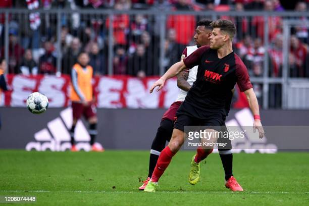 Jerome Agyenim Boateng of Bayern Muenchen and Florian Niederlechner of FC Augsburg during the Bundesliga match between FC Bayern Muenchen and FC...