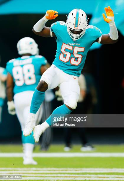 Jerome Baker of the Miami Dolphins celebrates after scoring a touchdown against the New York Jets in the fourth quarter of their game at Hard Rock...