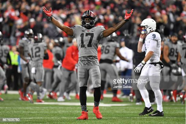 Jerome Baker of the Ohio State Buckeyes celebrates after stopping Penn State on downs in the fourth quarter as quarterback Trace McSorley of the Penn...