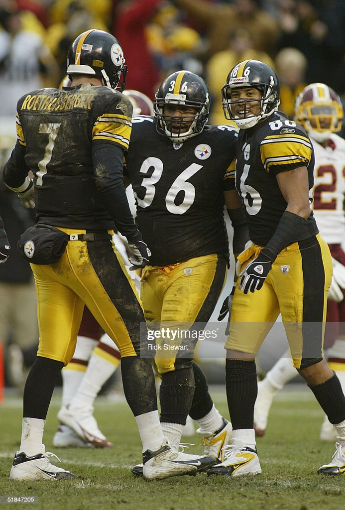 Jerome Bettis #36 of the Pittsburgh Steelers celebrates with his teammates quarterback Ben Roethlisberger #7 and flanker Hines Ward #86 during the game against the Washington Redskins on November 28, 2004 at Heinz Field in Pittsburgh, Pennsylvania. The Steelers defeated the Redskins 16-7.