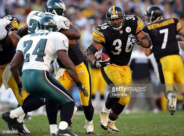 Jerome Bettis of the Pittsburgh Steelers looks for an opening as Sheldon Brown of the Philadelphia Eagles waits in the third quarter at Heinz Field...