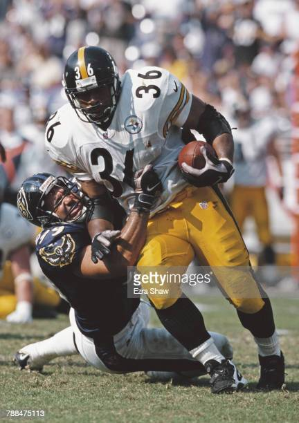 Jerome Bettis Running Back for the Pittsburgh Steelers is tackled Michael McCrary defensive end for the Baltimore Ravens during the American Football...