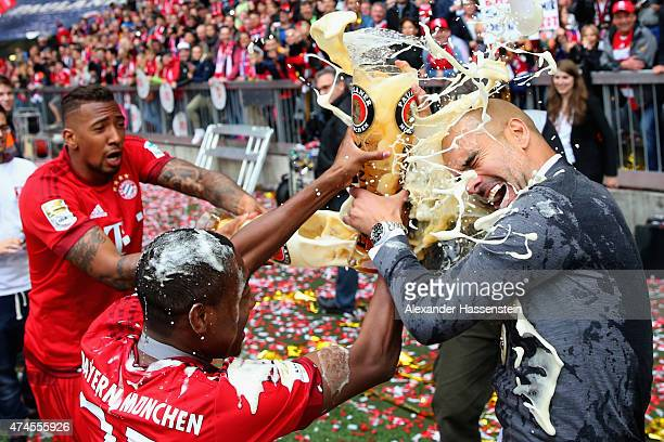 Jerome Boateng and David Alaba of Bayern Muenchen and Josep Guardiola the head coach of Bayern Muenchen celebrate after winning the league during the...