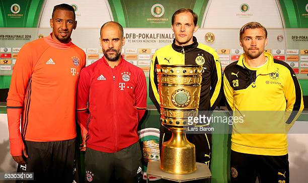 Jerome Boateng and head coach Josep Guardiola of Bayern Muenchen and head coach Thomas Tuchel and Marcel Schmelzer of Borussia Dortmund pose with the...