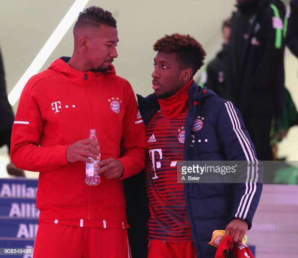 Jerome Boateng and Kingsley Coman of FC Bayern Muenchen chat at the players' tunnel before the Bundesliga match between FC Bayern Muenchen and Werder...