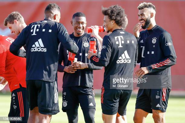 Jerome Boateng David Alaba Leroy Sane and Eric Maxim ChoupoMoting of FC Bayern Muenchen smile during a training session at Saebener Strasse training...
