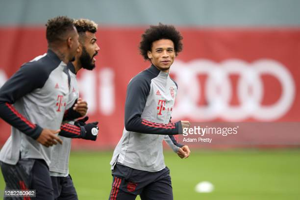 Jerome Boateng Eric Maxim ChoupoMoting and Leroy Sane of FC Bayern Muenchen jog during a training session ahead of the UEFA Champions League Group A...