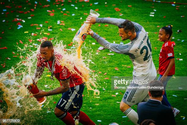 Jerome Boateng gets a beer shower by Sven Ulreich of Bayern after the Bundesliga match between FC Bayern Muenchen and VfB Stuttgart at Allianz Arena...