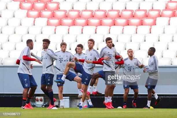 Jerome Boateng Kingsley Coman Mickael Cuisance Benjamin Pavard Thomas Mueller Oliver BatistaMeier Thiago and David Alaba of FC Bayern Muenchen warm...