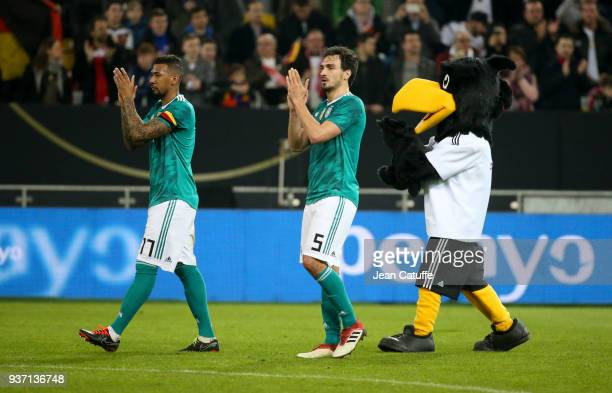Jerome Boateng Mats Hummels of Germany and Paule the mascot of Team Germany following the international friendly match between Germany and Spain at...