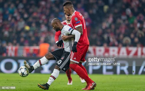 Jerome Boateng of Bayern challenges Vagner Love of Besiktas during the UEFA Champions League Round of 16 First Leg match between Bayern Muenchen and...