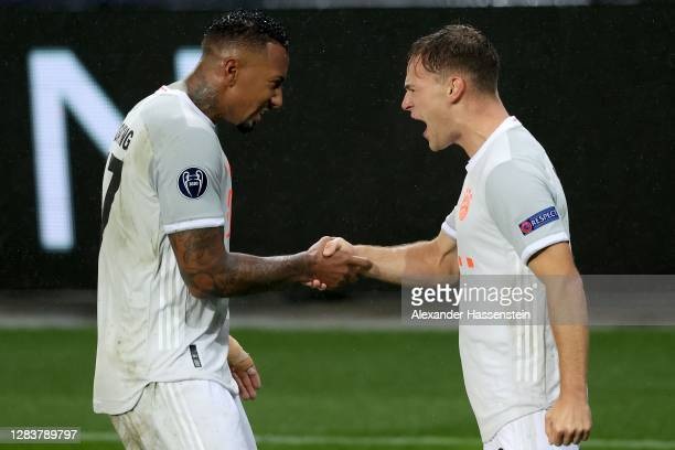 Jerome Boateng of Bayern München celebrates scoring the 3rd team goal with his team mate Joshua Kimmich during the UEFA Champions League Group A...