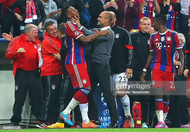 Jerome Boateng of Bayern Muenchen celebrates his goal with coach Josep Guardiola of Bayern Muenchen during the UEFA Champions League Group E match...