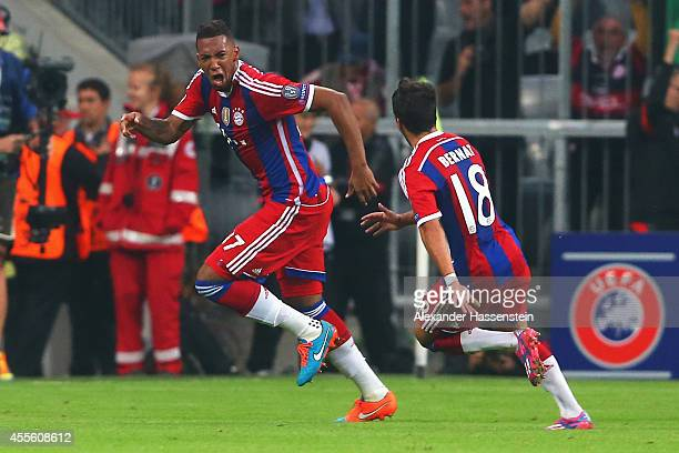 Jerome Boateng of Bayern Muenchen celebrates his goal with Juan Bernat of Bayern Muenchen during the UEFA Champions League Group E match between...