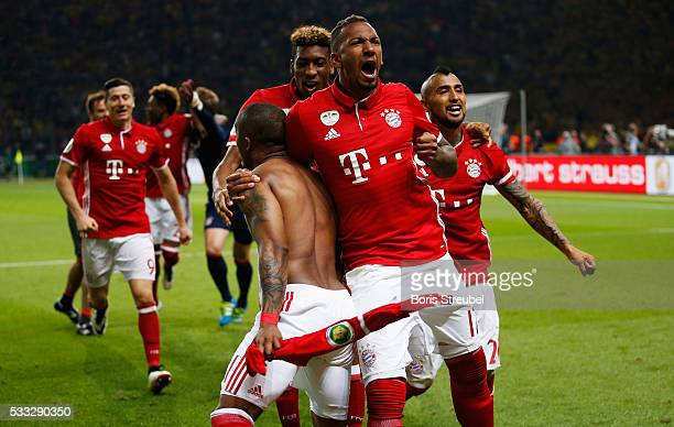 Jerome Boateng of Bayern Muenchen celebrates victory with team mates after the DFB Cup final match between FC Bayern Muenchen and Borussia Dortmund...