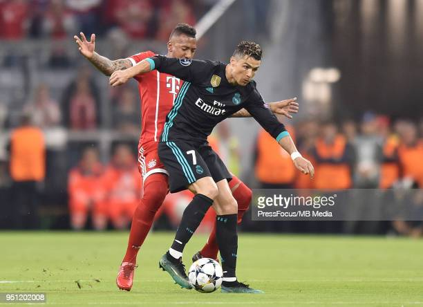 Jerome Boateng of Bayern Muenchen competes with Cristiano Ronaldo of Real Madrid during the UEFA Champions League Semi Final First Leg match between...