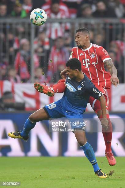 Jerome Boateng of Bayern Muenchen fights for the ball with Serge Gnabry of Hoffenheim during the Bundesliga match between FC Bayern Muenchen and TSG...