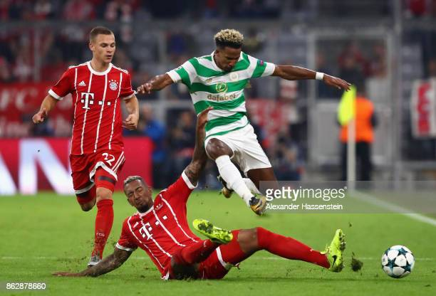 Jerome Boateng of Bayern Muenchen fouls Scott Sinclair of Celtic during the UEFA Champions League group B match between Bayern Muenchen and Celtic FC...
