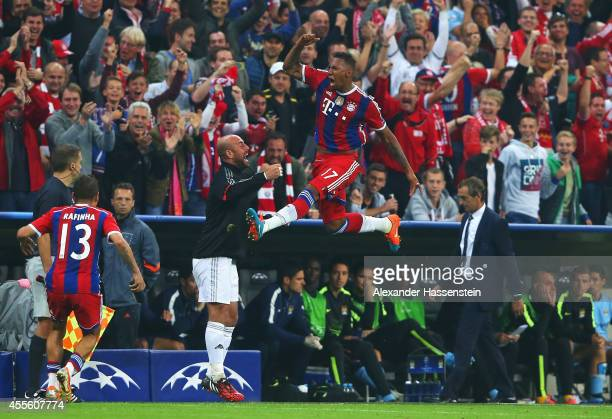 Jerome Boateng of Bayern Muenchen jumps for joy as he celebrates scoring his goal with team mates during the UEFA Champions League Group E match...