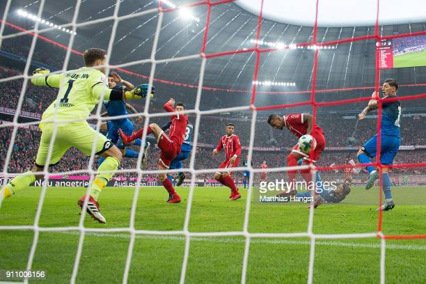 Jerome Boateng of Bayern Muenchen scores a goal to make it 22 during the Bundesliga match between FC Bayern Muenchen and TSG 1899 Hoffenheim at...