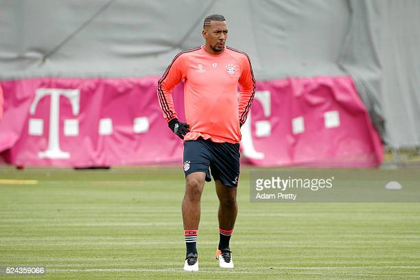 Jerome Boateng of Bayern Muenchen stretches during a training session ahead of the UEFA Champions League Semi Final First Leg between Club Atl��tico...