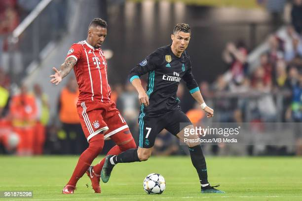 Jerome Boateng of Bayern Muenchen tackles Cristiano Ronaldo of Real Madrid during the UEFA Champions League Semi Final First Leg match between Bayern...