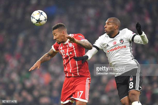 Jerome Boateng of Bayern Muenchen wins a header from Ryan Babel of Besiktas during the UEFA Champions League Round of 16 First Leg match between...