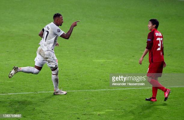 Jerome Boateng of Bayern Munich celebrates after scoring his sides third goal during the UEFA Champions League Group A stage match between RB...