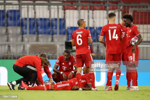 Jerome Boateng of Bayern Munich receives medical treatment during the UEFA Champions League round of 16 second leg match between FC Bayern Muenchen...