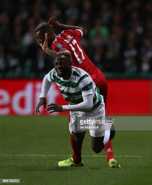 Jerome Boateng of Bayern Munich vies with Moussa Dembele of Celtic during the UEFA Champions League group B match between Celtic FC and Bayern...