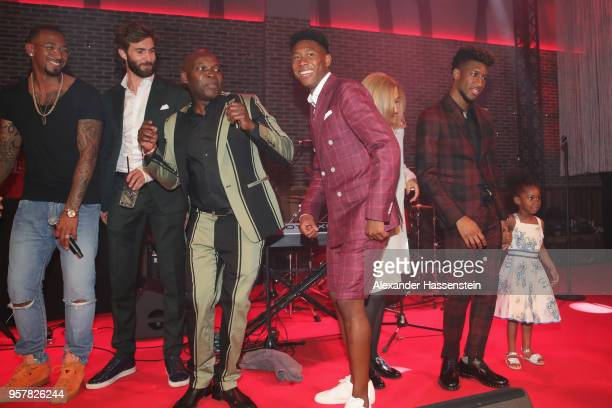 Jerome Boateng of FC Bayern Muenchen and his team mate David Alaba attend the FC Bayern Muenchen Celebration 2018 Party at Nockherberg on May 12 2018...